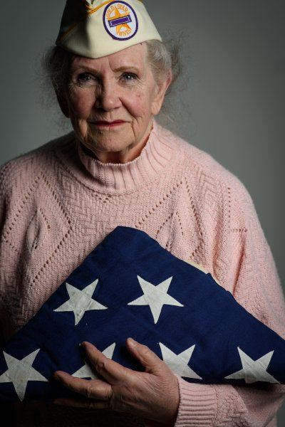 Gold Star Wives Member holding a Flag